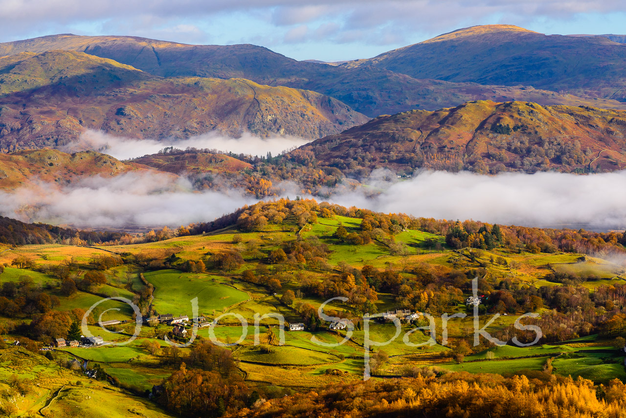 Loughrigg Fell is in the middle ground, with mist both in front and behind